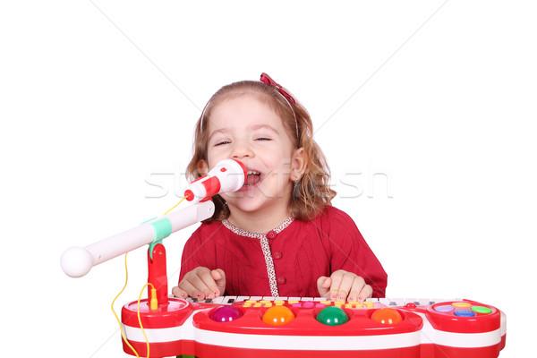 Küçük kız şarkı söylemek oynamak müzik gülümseme çocuk Stok fotoğraf © goce