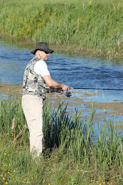рыбак удочка реке рыбы спорт зеленый Сток-фото © goce