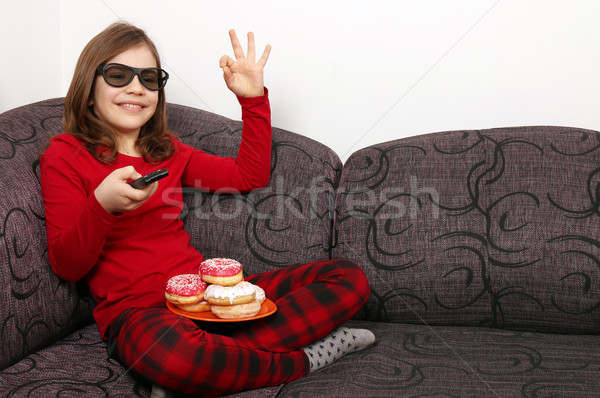 Boldog kislány televízió előadás lány étel Stock fotó © goce