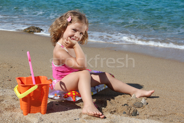 little girl with toys posing on the beach Stock photo © goce