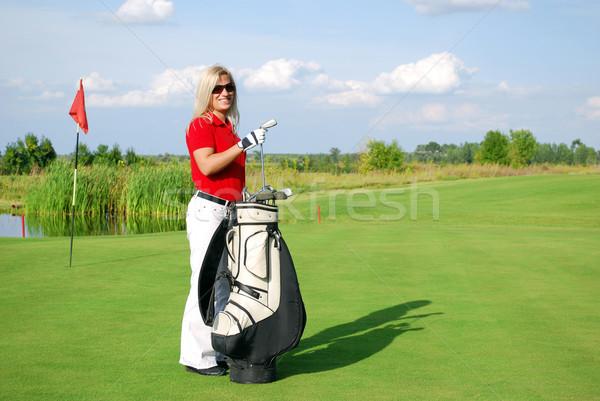 girl golf player with golf bag Stock photo © goce