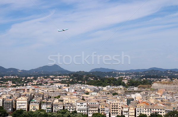 passenger airplane flying over Corfu town Greece Stock photo © goce