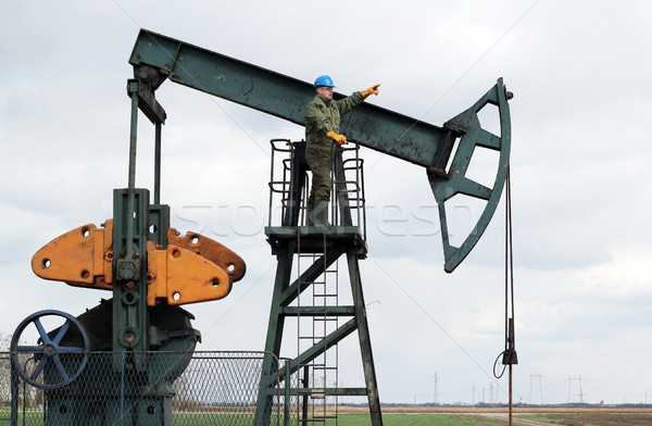 oil worker stands at the pump jack Stock photo © goce