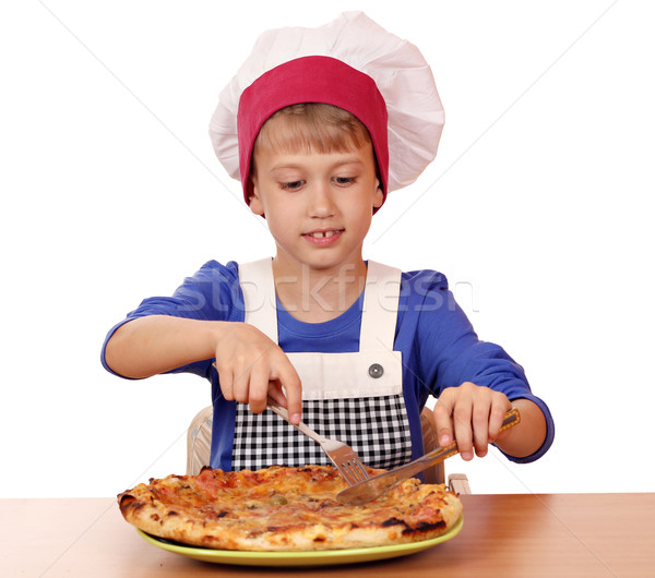 hungry boy chef eat pizza Stock photo © goce