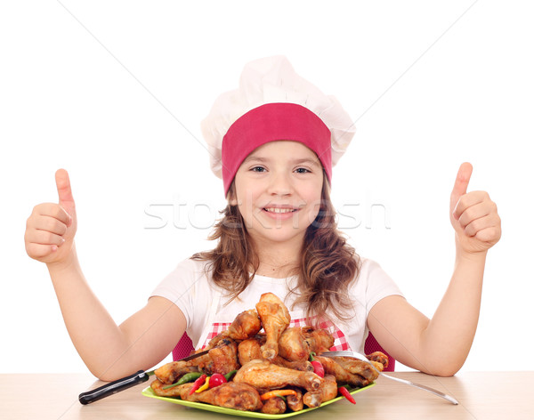 happy little girl cook with roasted chicken drumstick and thumbs Stock photo © goce