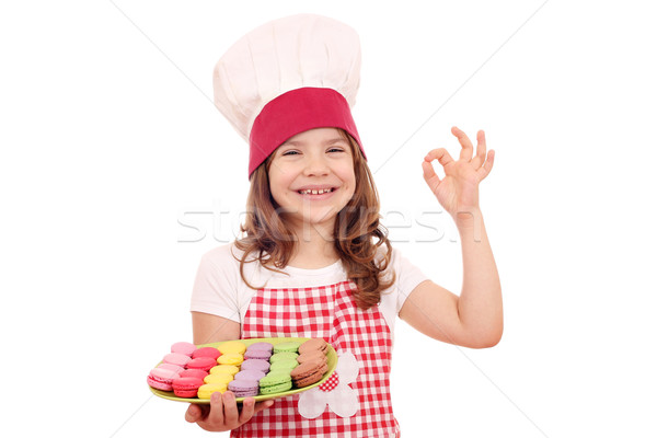 happy little girl cook with sweet macarons and ok hand sign Stock photo © goce
