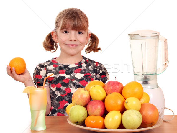 beautiful little girl make fruit juice Stock photo © goce
