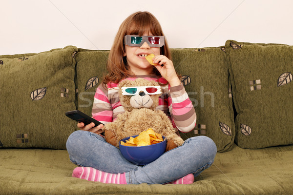 little girl with 3d glasses eat chips and watching tv Stock photo © goce