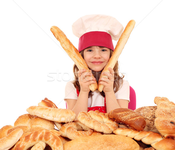 little girl cook with buns bread and pretzel Stock photo © goce