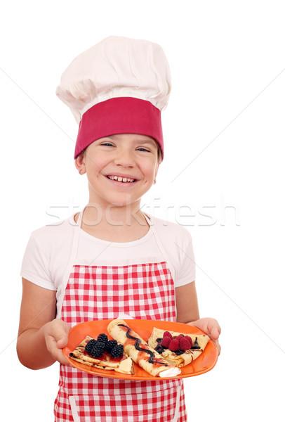Boldog kislány szakács édes mosoly gyermek Stock fotó © goce
