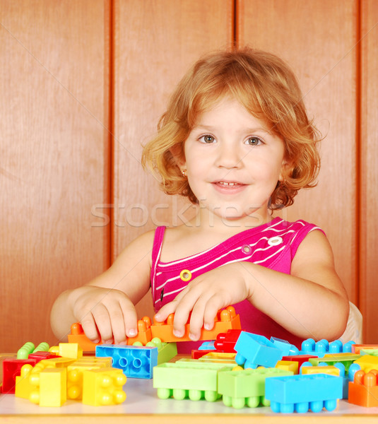 little girl play with toy blocks Stock photo © goce
