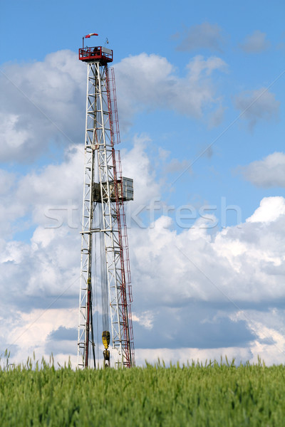oil drilling rig and blue sky Stock photo © goce