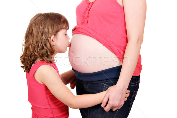 little girl kissing belly of pregnant mother Stock photo © goce
