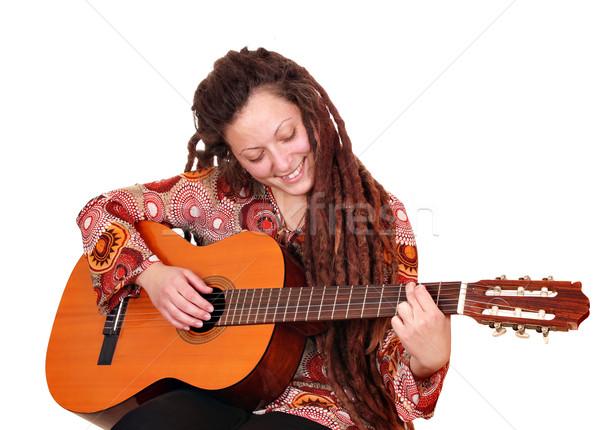 girl with dreadlocks hair play guitar Stock photo © goce