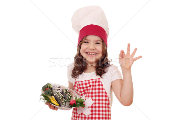 happy little girl cook with fish and ok hand sign Stock photo © goce