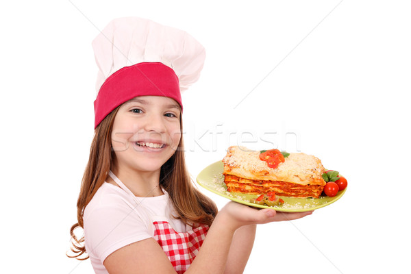 Feliz little girl cozinhar saboroso lasanha prato Foto stock © goce