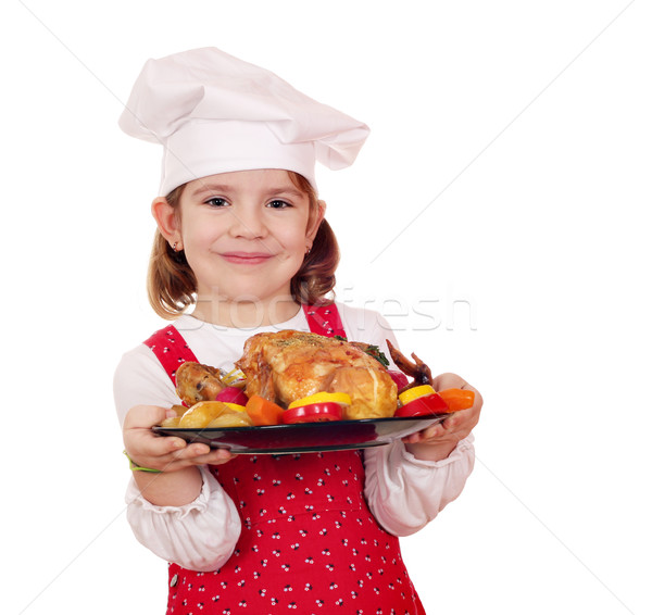 Kislány szakács tart pörkölt tyúk boldog Stock fotó © goce