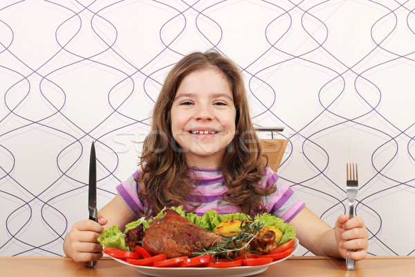 hungry little girl with turkey drumstick Stock photo © goce