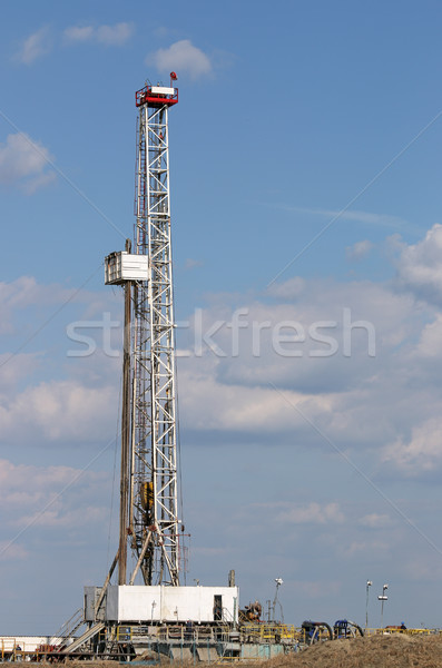 Oil drilling rig and mining equipment on oilfield Stock photo © goce
