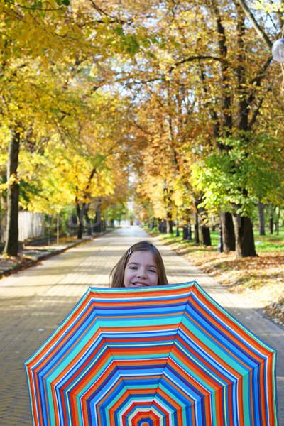 little girl with umbrella autumn season Stock photo © goce