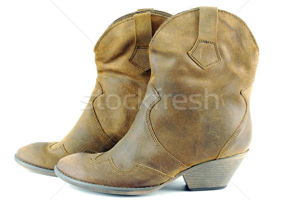 Mulher marrom couro botas de vaqueiros moda sapato Foto stock © goce