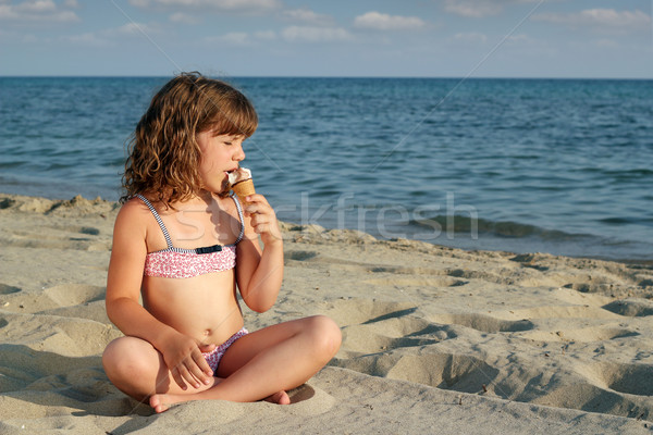 photo of girls sitting in water at beach № 16905