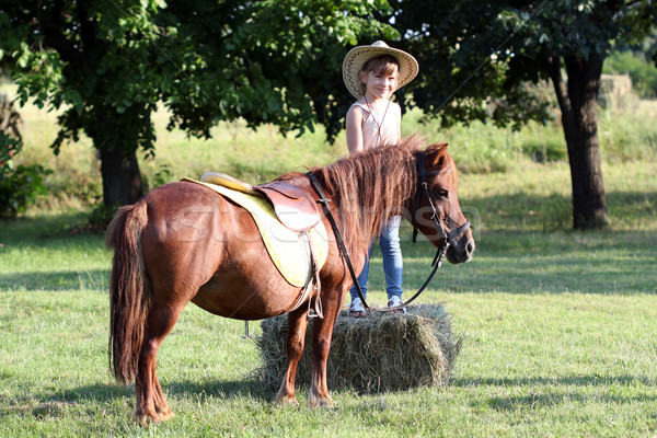 Petite fille chapeau de cowboy poney cheval animal fille Photo stock © goce