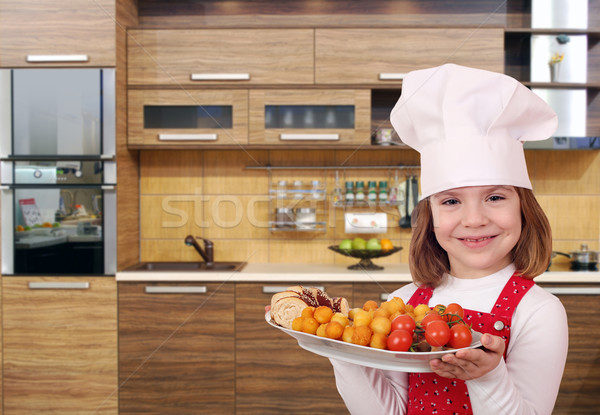 little girl cook with gourmet food in kitchen Stock photo © goce