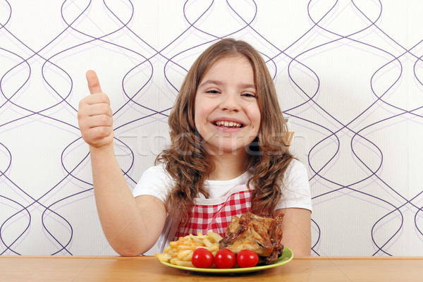 happy little girl with roasted chicken wings and thumb up Stock photo © goce