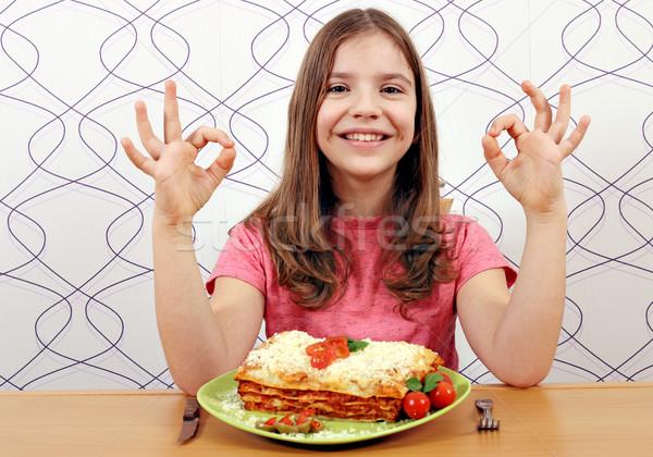 Feliz little girl lasanha sinal da mão menina Foto stock © goce