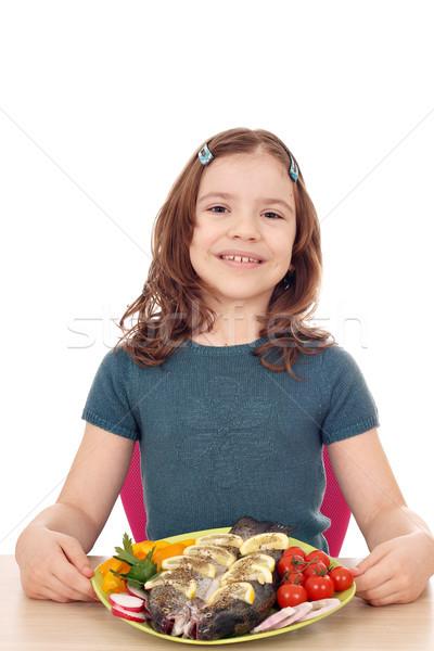 Boldog kislány pisztráng hal gyermek jókedv Stock fotó © goce