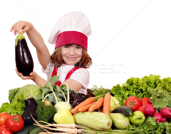 little girl cook holding aubergine Stock photo © goce