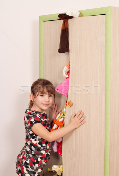 unhappy little girl with messy closet Stock photo © goce