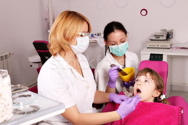 dentist nurse and little girl patient Stock photo © goce