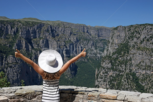 Stock photo: girl with thumbs up on the viewpoint Vikos gorge Greece