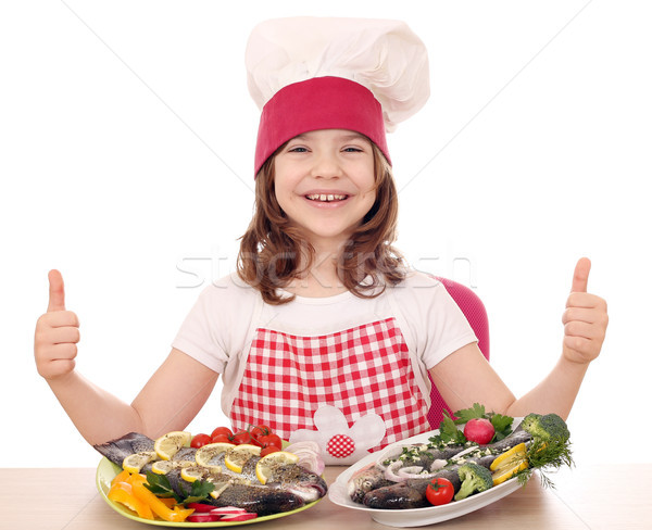Feliz nina cocinar trucha placa Foto stock © goce