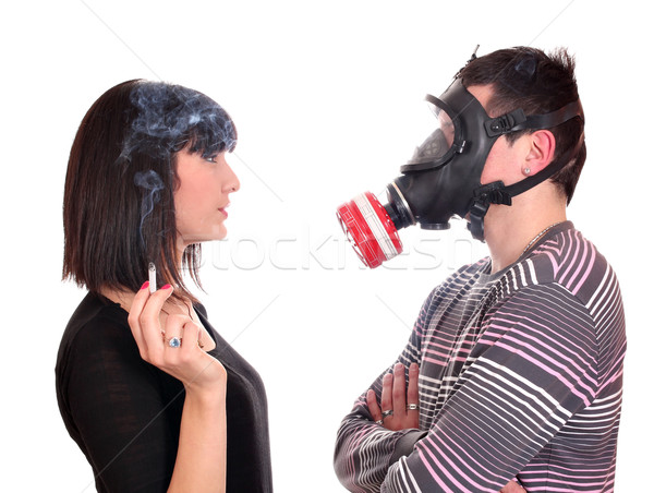 man with gas mask protects against tobacco smoke Stock photo © goce