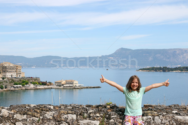 Stock photo: Happy little girl with thumbs up Corfu town Greece