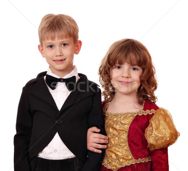 Jongen smoking meisje gouden jurk poseren Stockfoto © goce