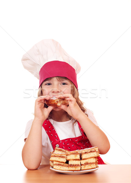 hungry little girl cook eating apple cake Stock photo © goce