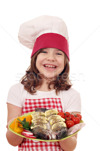 happy little girl cook with fish  Stock photo © goce