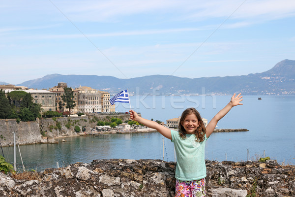 happy little girl with Greek flag on summer vacation Corfu town  Stock photo © goce