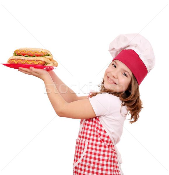 Mutlu küçük kız pişirmek sıcak köpekler fast-food Stok fotoğraf © goce