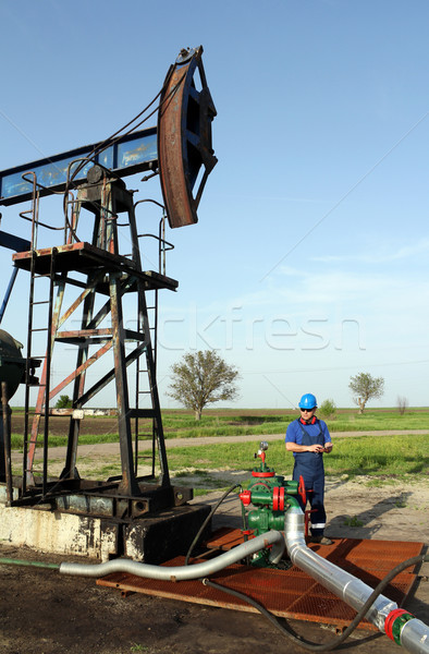 oil worker with tablet pc check pipeline Stock photo © goce
