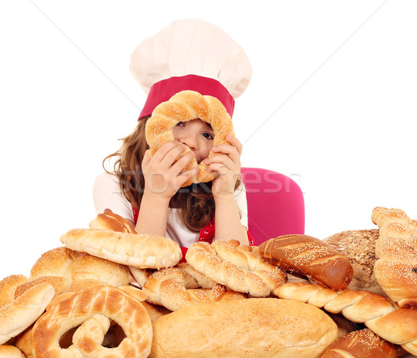Petite fille Cook pain bretzels fille Kid Photo stock © goce
