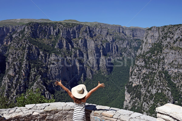 girl with hands up on the viewpoint Vikos gorge Greece Stock photo © goce