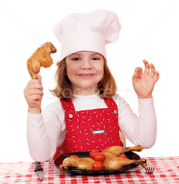 little girl cook with chicken drumstick Stock photo © goce