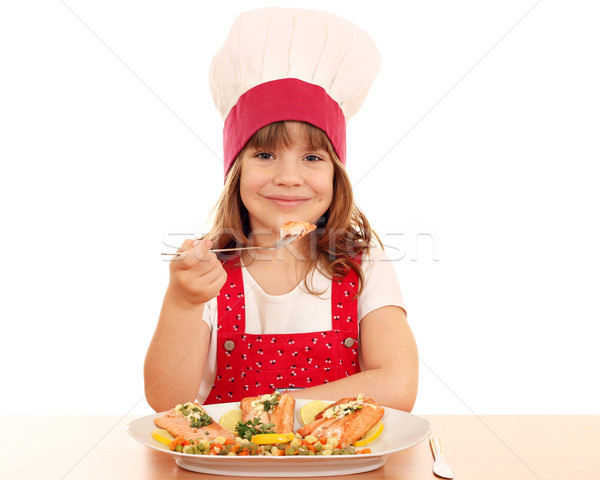 hungry little girl cook eating salmon Stock photo © goce