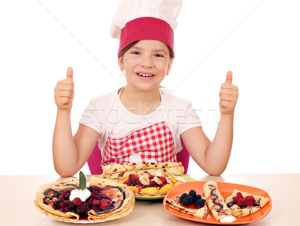 happy little girl cook with crepes and thumbs up Stock photo © goce