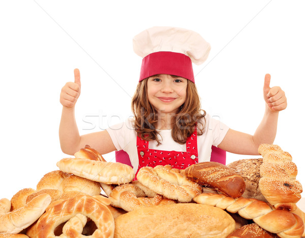 little girl bakery with thumbs up and breads Stock photo © goce